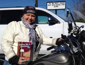 Kym bike and book 1-15 CROP